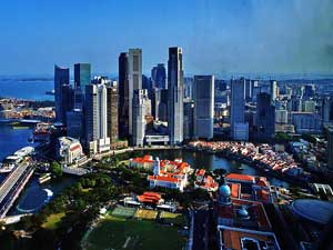 Singapore property sales volume halved in April